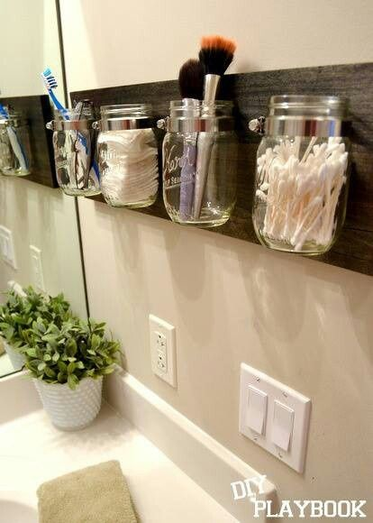 Repinned: Mason jars mounted in bathroom- could do this with all my jars left over from the wedding.