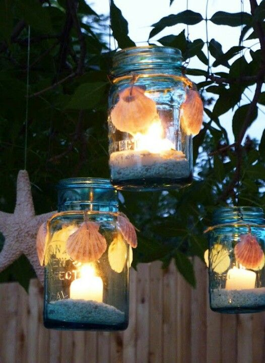 Beach theme mason jars as hanging lanterns.. or place on a table as a center piece.  also its a dyi project.