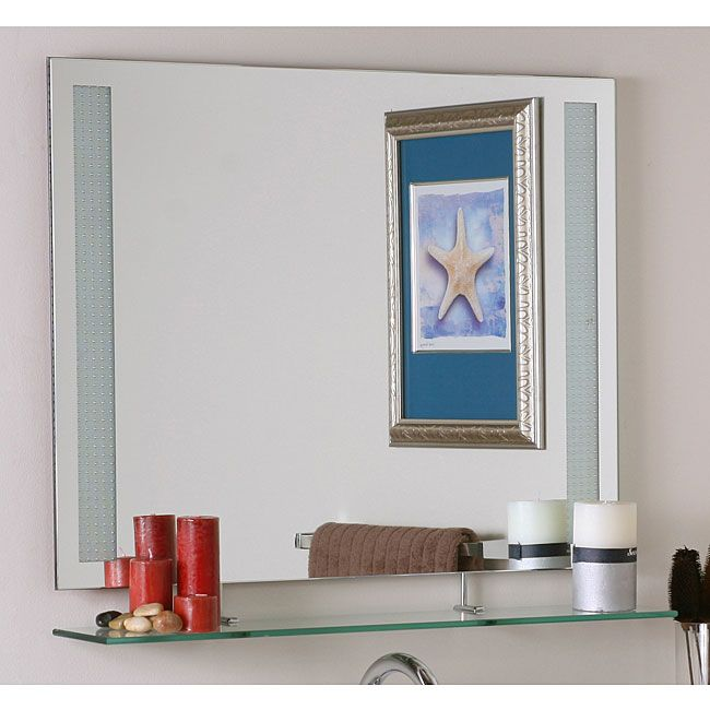 a pose in front of this stylishly modern frameless wall mirror