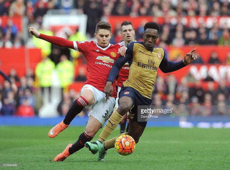 Danny Welbeck of Arsenal is challenged by Guillermo Varela of Man Utd during the Barclays Premier League match between Manchester United and Arsenal at Old Trafford on February 28, 2016 in Manchester, United Kingdom.