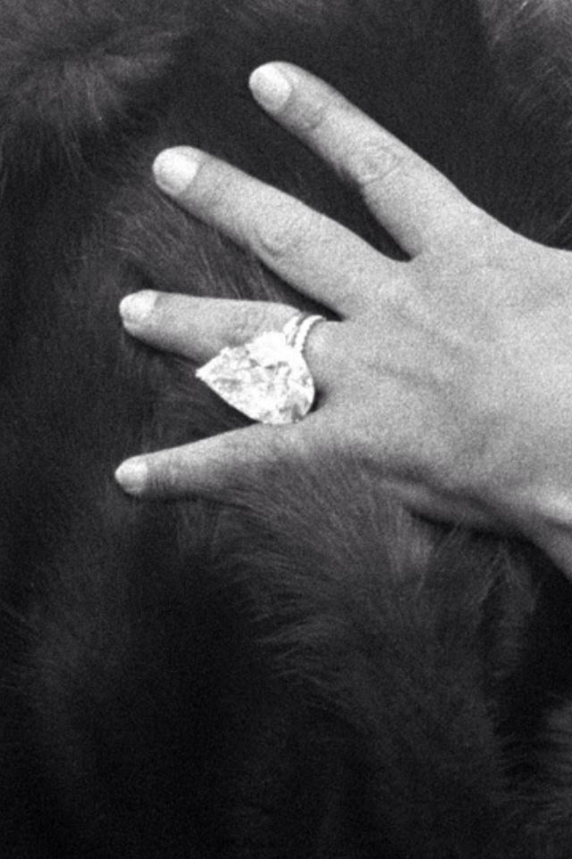 The Taylor-Burton 69.42 carat diamond in it's original setting, before it was converted into a necklace by Cartier.
