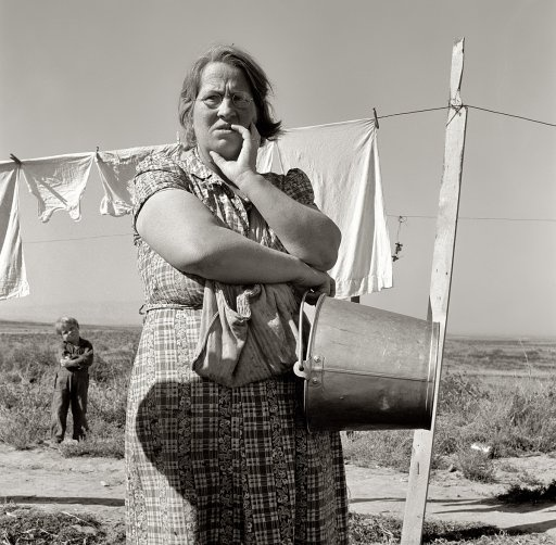 "September 1939. ""Mrs. Soper, FSA client, tells how it was when the family first came."" Willow Creek area, Malheur County, Oregon.  by Dorothea Lange"