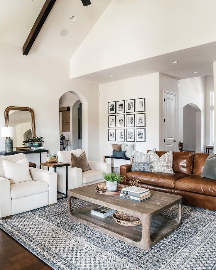 Warm White Walls With Dark Wood Ceiling Beams Gallery Wall And