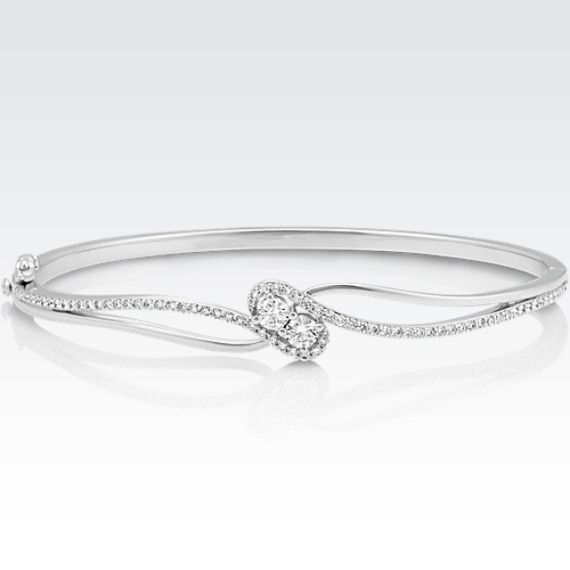 Adding exquisite sparkle to the wrist party with this diamond bangle bracelet.