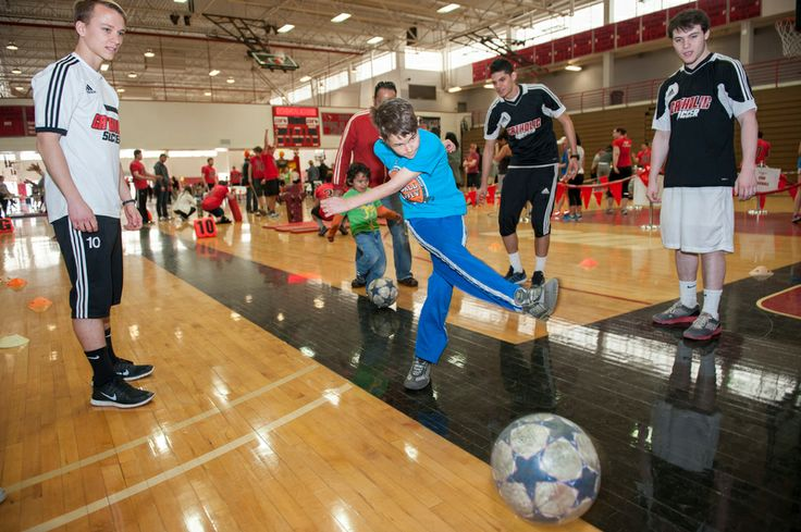 On April 6, children and families from the Brookland neighborhood participated in a field day featuring games and activities focused on athletics at the Raymond A. DuFour Athletic Center. All of the volunteers for the first-time event were Catholic University student athletes.