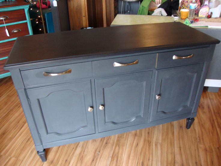 A buffet updated with graphite Annie Sloan chalk paint with a black top!