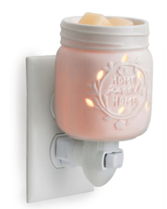 "Inspired by the famous home canning jars, this porcelain fragrance warmer glows when lit with the phrase ""home sweet home."" Add your favorite scented wax melts to the screw top styled dish. A rotating"