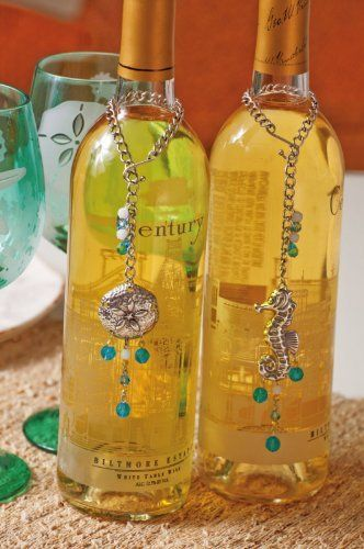 """Metal Wine Bottle Charm 2 Asst, Sounds of the Sea by Evergreen. $20.29. 2 Assorted. Great for yourself or as a gift. 6"""" Hanging. Add an elegant panache to your wine bottles with beads the color of the water and charms that look plucked from the ocean's waves. Wrapping around the bottle's slender neck, these silver charms hang like an embrace. The silver seahorse and sand-dollar steal all attention and show off the beauty of the ocean."""