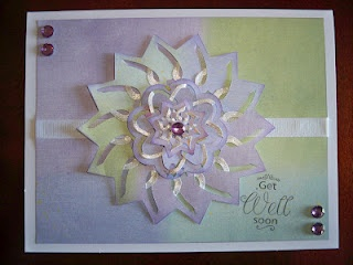 Was thinking this would make a very cool and elegant Christmas card.  From Spellbinders Cut Fold Tuck series