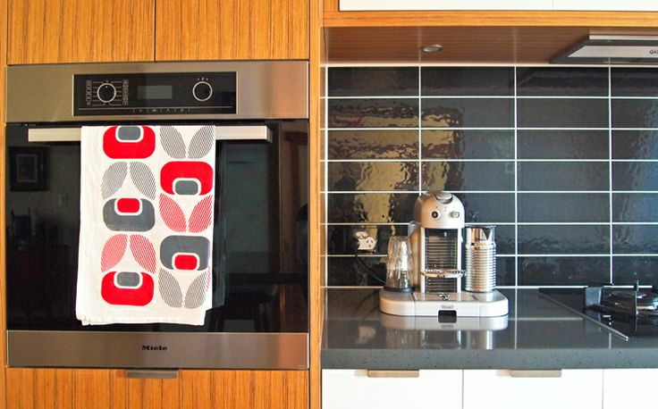 Kitchen designed by Jasmine McClelland  Tea towel by US