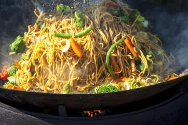 Sauteing Chinese chow mein - Brian Stablyk/Photographer's Choice RF/Getty Images