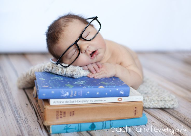 Love the idea of photographing baby with books we hope to read to him her