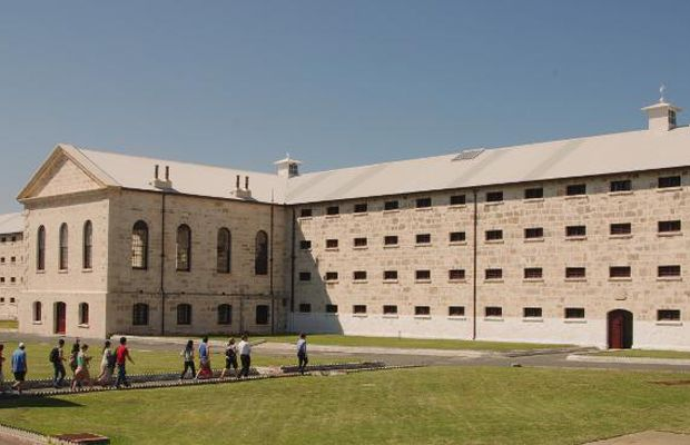 Fremantle Prison Location: Western Australia Notable Residents: Bon Scott (lead singer of AC/DC) Amenities: An impressive art gallery  On this 15-acre site, you can find the former prison, gatehouse, cottages, perimeter walls, and even prisoner art.