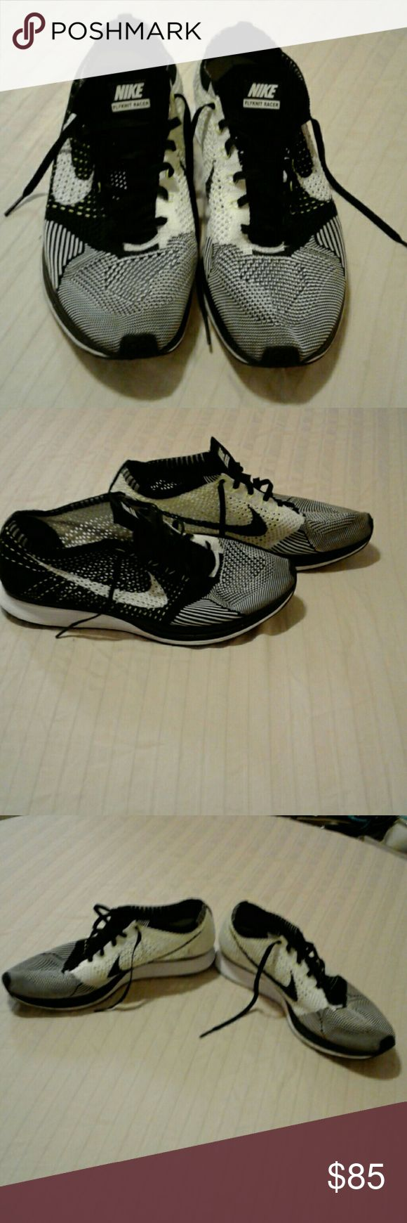 Men's  Nike Flyknit Racer shoes Black, white and some neon tellow treading. Outside of shoes is mainly back with white and some neon threads. The inner side of the shoes is mainly white with some black and some neon yellow thread. In great condition. Nike Shoes