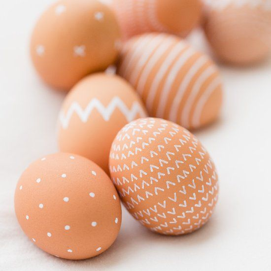 Make naturally beautiful Easter eggs using fresh brown eggs and a non-toxic white paint pen.