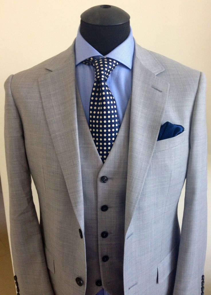 This suit is another example of a customer creation that has become a staple design.  Aaron created a 3-piece light grey suit, but substituted dark navy tortoise buttons.  The resulting accents make the suit stand out, but when added to the vest, make it a year-round outfit.  Nice job, Aaron - you make us all proud!