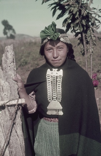 Chile | Araucanian woman with elaborate silver jewellery. | ©W Robert Moore