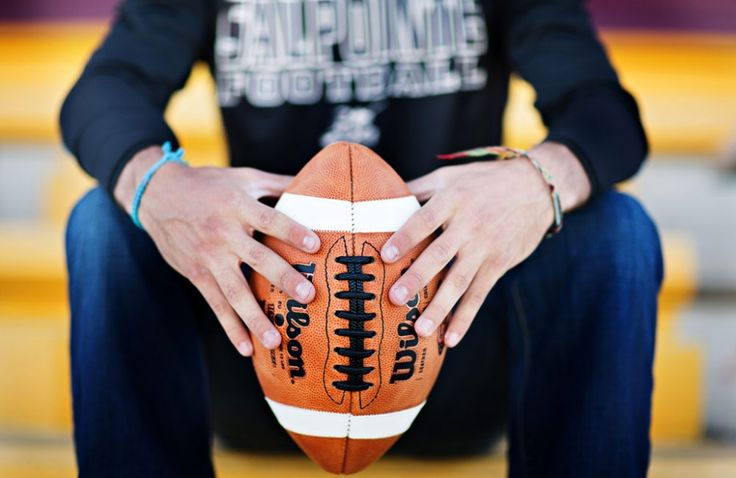 senior guy photo sessions with football