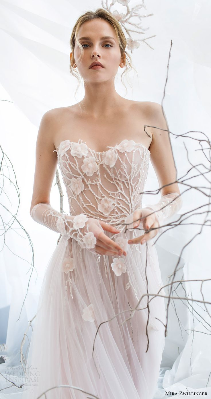 Amazing dress from 2017 collection by Mira Zwillinger, the transparant bodice makes it look ethereal.