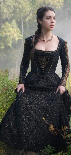 Mary in black beaded gown.
