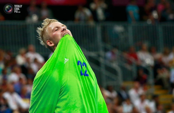 Day 16 - Sweden's goalkeeper Johan Sjostrand bites his jersey after letting in a goal scored by France during the men's gold medal handball match at the London 2012 Olympic Games at the Basketball Arena. ADREES LATIF/REUTERS