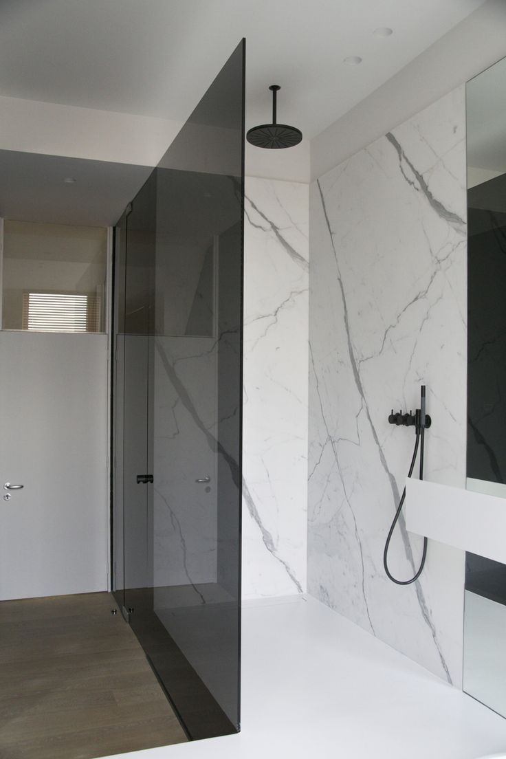shower calacatta marble black Vola shower head tap white liquid floor