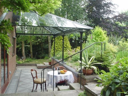Love These Glass And Iron Canopy Porch/Patio Covers!