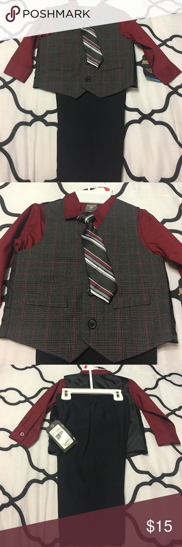 Dockers suit Dockers 4 piece suit. Dark red shirt stripped vest and tie. Black pants with detachable clip tie. Brand new with tags. Size 24 months Other
