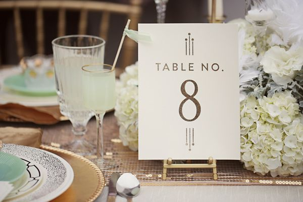 Gold Chargers and simple table number.  Love the stand it's on.