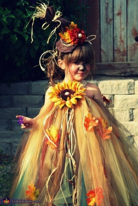 I made this scarecrow costume for my 2 year, Bella. After putting out my fall decoration Bella became obsessed with scarecrow and tossed my pretty princess Halloween costume idea out the window. Bella was adamant on being a scarecrow. I couldnt find a cute enough costume so I decided to create my own. I used tulle, fall leaves, raffia, glitter, ribbon and felt for the hat.