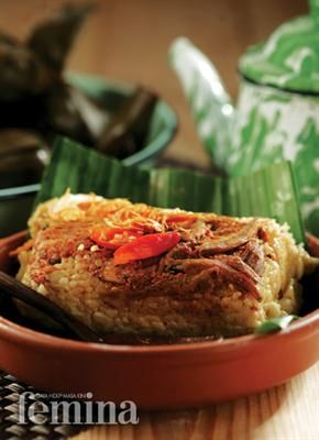Indonesian Food - Javanese Steamed Spicy Rice Dish - Sego Geghog from East Java.. - Wrapped with banana leaf..