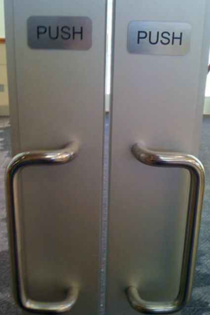 24 things that will go down as the most poorly designed of our time confusing pushpull door designs - Bad Design