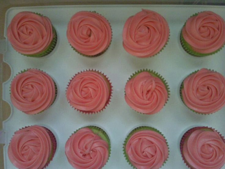 Made some rosebud cupcake for a tutus & tiaras baby shower.... got to top them with my tiaras