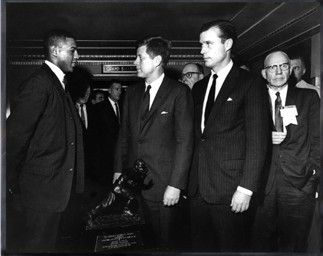 Ernie Davis with President Kennedy after receiving the Heisman Trophy.