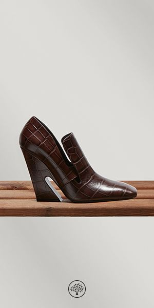 Shop the Palace Booties in Dark Brown Croc Leather at Mulberry.com. A timeless pair embracing a traditional shape made modern with subtle side cut outs and an exaggerated geometric heel. Crafted in croc print patterned calfskin leather, this bootie invigorates any outfit to ensure a fashionable look. Style with a classic pencil skirt or dress for daytime chic.