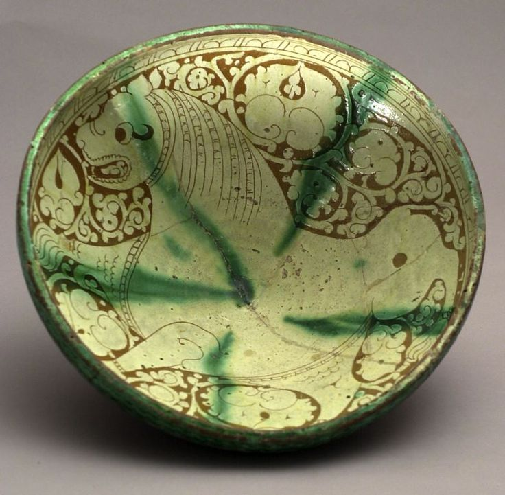 Bowl with Lioness, 12th/13th century  Earthenware with incised decoration and splashes of green in a transparent glaze. Iran