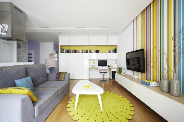 Interior. Wonderful Interior Design Ideas. Sweet Apartment Interior Inspiring Design Featuring White Stained Wooden Table And Gray Fabric Comfy Sofa Plus Yellow Blue Fabric Comfy Cushions Along With Colorful Stripes Wall Also White Stained Wooden Tv Cabinet Plus White Stained Wooden Shelf And Also Recessed Ceiling Lamp Also Brown Laminated Wooden Floor And Yellow Fabric Rug Plus Gray Clay Vase Also Cream Varnished Wooden Table And White Plastic Modern Chair And Also Colorful Stripes Fabric…