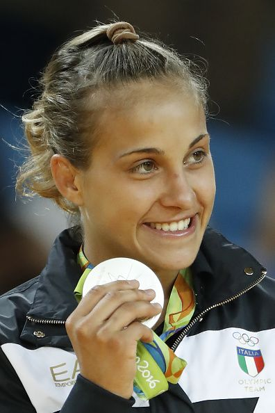 Silver medallist Italy's Odette Giuffrida celebrates on the podium of the women's 52kg judo contest of the Rio 2016 Olympic Games in Rio de…