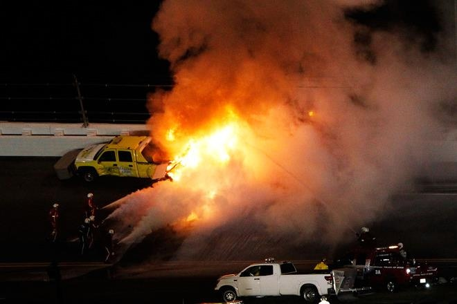 DAYTONA BEACH, FL - FEBRUARY 27: Safety workers try to extinguish a fire from a jet dryer after being hit by Juan Pablo Montoya, driver of the #42 Target Chevrolet, under caution during the NASCAR Sprint Cup Series Daytona 500 at Daytona International Speedway on February 27, 2012 in Daytona Beach, Florida. (Photo by Tom Pennington/Getty Images for NASCAR) 2012 Getty Images