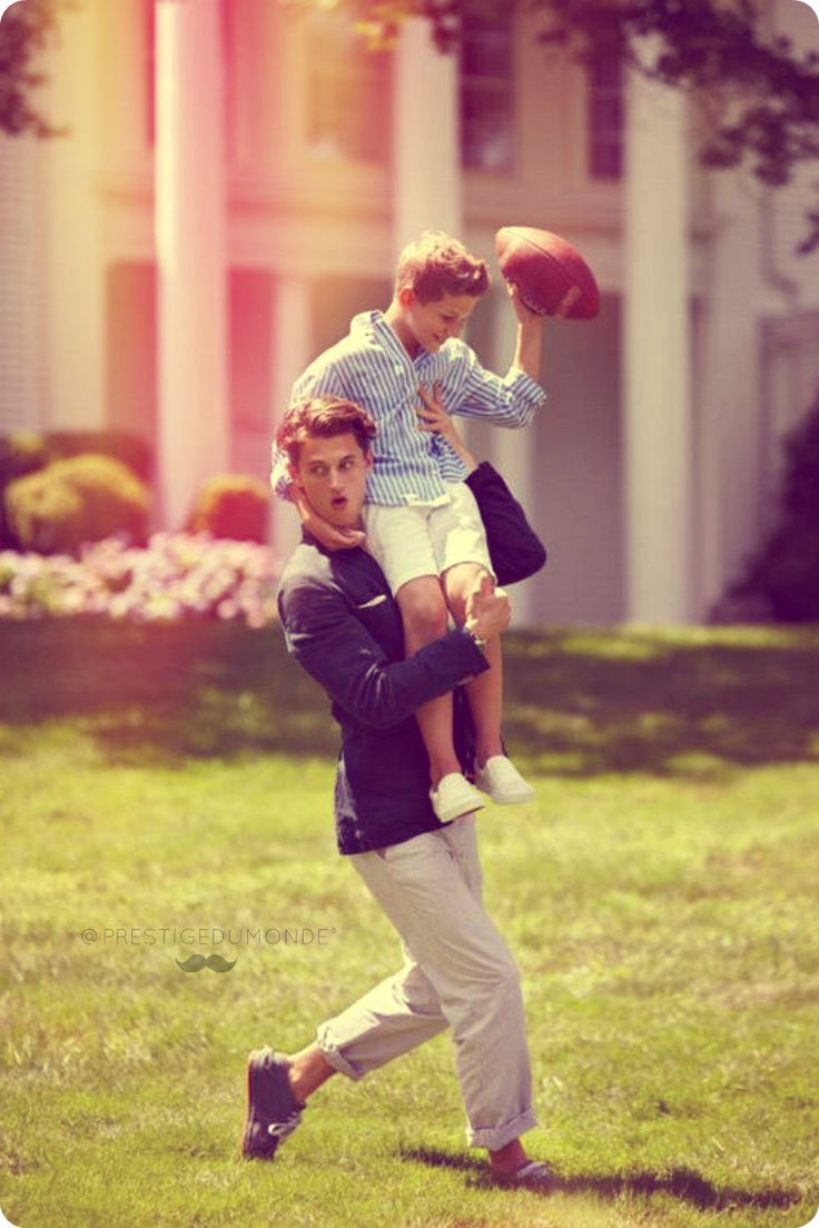 A family making happy memories on a sunny Sunday afternoon while playing a friendly game of touch football.