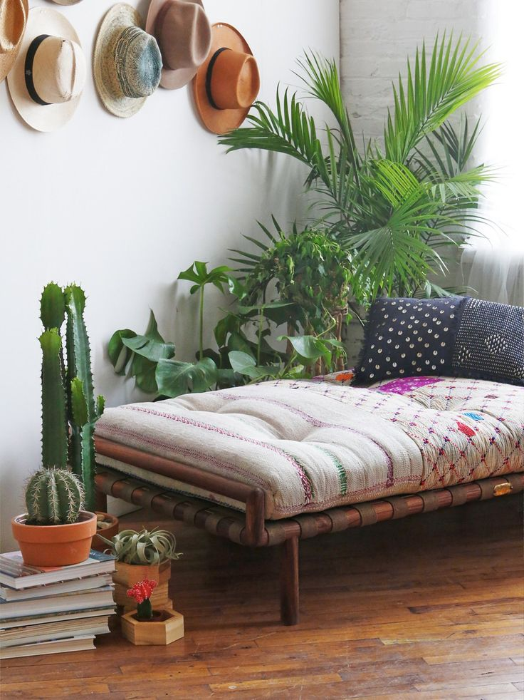 Delamo Weave Day Bed   Relax on this super comfy lounge bed featuring a one-of-a-kind tufted mattress. Sits low to the ground on a wooden base. Upholstery is made from vintage quilts found in India that were made by families using their recycled cotton saris, hand sewn together into sleeping quilts. Hand-touched and hand-chosen, every piece from our FP Sanctuary collection has journeyed around the world to create a living space as free-spirited as you are.