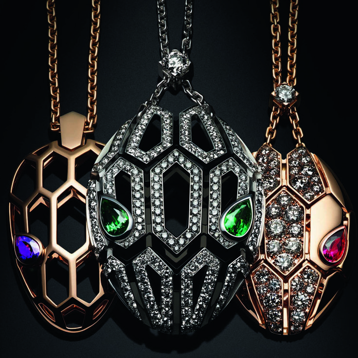 A trio of Bulgari Serpenti Seduttori pendant necklaces in rose and white gold with emerald, rubellite or amethyst eyes and different diamond setting options.