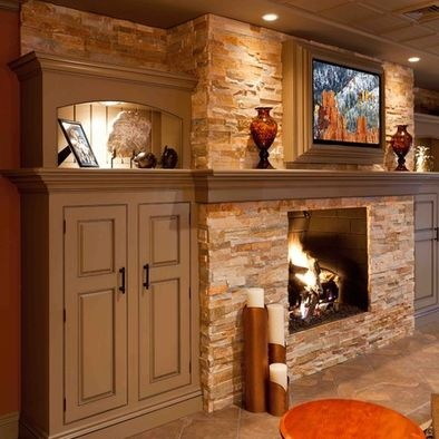 Mantel with stone - upstairs fireplace - add a mantel and bookshelves on the sides.Shelves will go to the ceiling