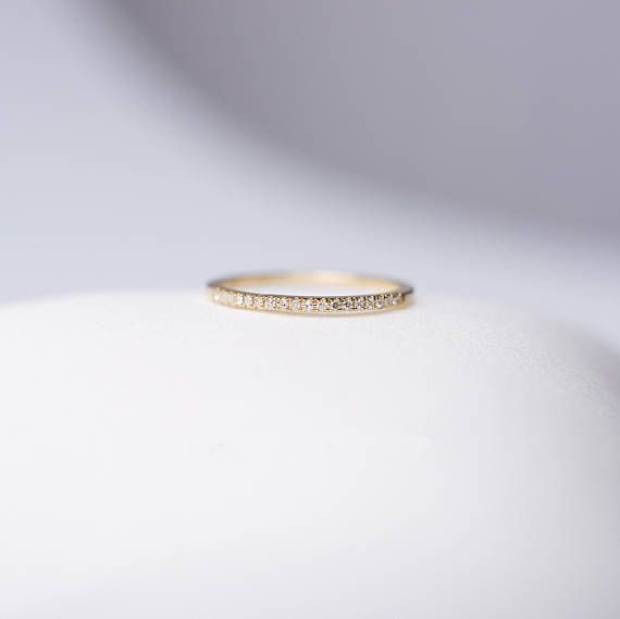 Simple half eternity wedding band, made in solid 14k/18k gold, set with 16 diamonds. Classical and easy to match all enegament rings.  ♥ Material: Solid 18K gold; 16*0.006 VS clarity diamonds in total, excellent cut, G-H color; ♥ Dimension: Thickness 1.3mm approx; FREE WORLDWIDE SHIPPING.  Crafting time is approximately 2-3 weeks. Every piece of jewerly here is lovingly hand made with a lot of passions from Sunday Island ♥