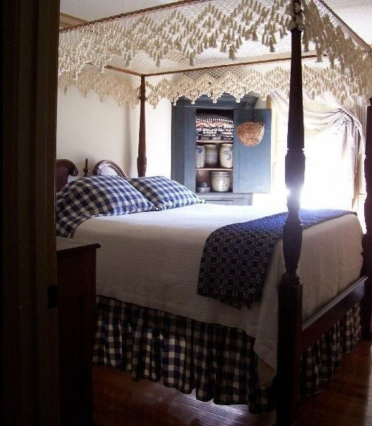 primitive bedroom.  The Primitive Stitcher Love the idea of hanging a table cloth over bed 159 best country primitive bedrooms images on Pinterest