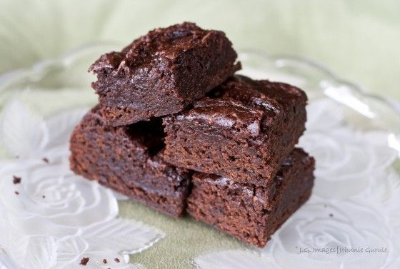 My sister used to bake these every day to sell at a cafe at school. I often bring these to vegetarian/vegan potlucks because they are quick and everyone seems to really like them.  Please note - these are pretty good, but the other vegan brownie recipe I have posted (Recipe #25230) is way better!! (I think).
