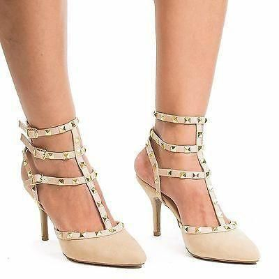 5d043ecfa2b Gladiator-esq two-toned pointed toe Dorsey pump featuring open back ...