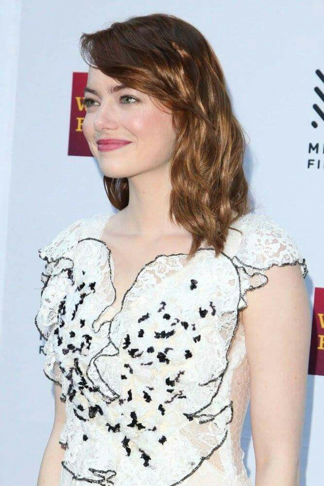 Emma Stone poses for photos on the Mill Valley Film Festival red carpet at The Outdoor Art Club on October 6, 2016 in Mill Valley, California.