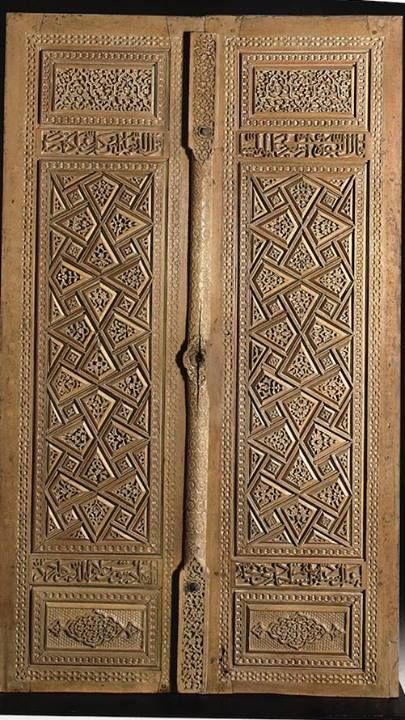 Iran:  892 H/1487 CE Carved wood with traces of paint 189 x 106cm Inscription (lower panels): 'The work of Ustad ibn...Ustad Hajji the carpenter (al-Najjar) with the...of Darvish Ala uddin, work (completed) in the year 892