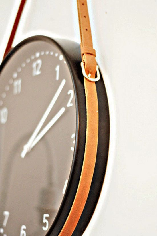 clock and two skinny leather belts.